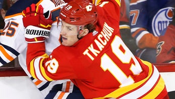 Calgary Flames' Matthew Tkachuk delivers huge hit on Edmonton Oilers' Zack Kassian, sparking brawl