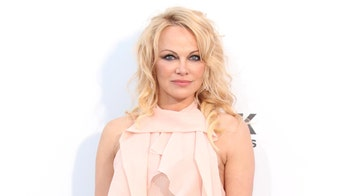 Pamela Anderson marries her bodyguard in intimate Christmas wedding