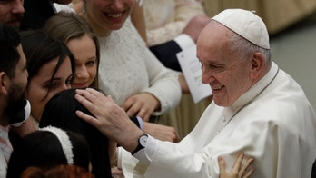 Pope Francis agrees to papal kiss after hand-slapping controversy with one condition: 'Don't bite!'