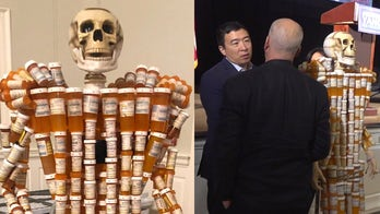 Skeleton 鈥榩ill man鈥� confronts presidential candidates about opioid epidemic