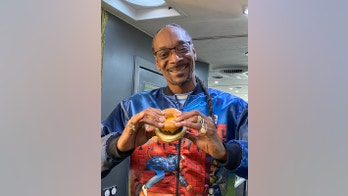 Dunkin' teams up with Snoop Dogg to introduce glazed doughnut breakfast sandwich