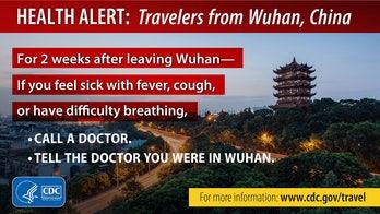 US airports displaying CDC warning posters amid coronavirus outbreak