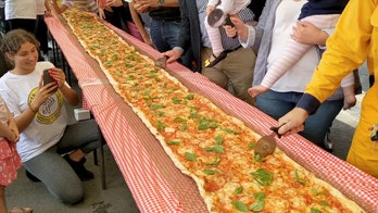 Italian restaurant makes 330-foot pizza to raise money for Australia firefighters