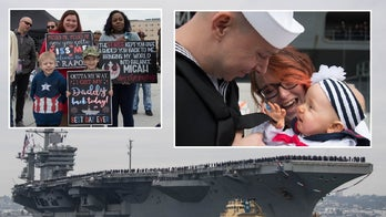 A joyous affair as USS Lincoln arrives after 10-month deployment, sailors meet babies for first time