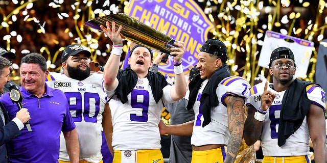 """NEW ORLEANS, LOUISIANA - JANUARY 13: Joe Burrow of the LSU Tigers raises the National Championship Trophy with Ed Orgeron, Grant Delpit #7, Patrick Queen #8, and Rashard Lawrence #90 after the College Football Playoff National Championship game at the Mercedes Benz Superdome on January 13, 2020 in New Orleans, Louisiana. The LSU Tigers <a data-cke-saved-href=""""https://www.foxnews.com/sports"""" href=""""https://www.foxnews.com/sports"""" target=""""_blank"""">https://www.foxnews.com/sports</a>topped the Clemson Tigers, 42-25. (Photo by Alika Jenner/Getty Images)"""