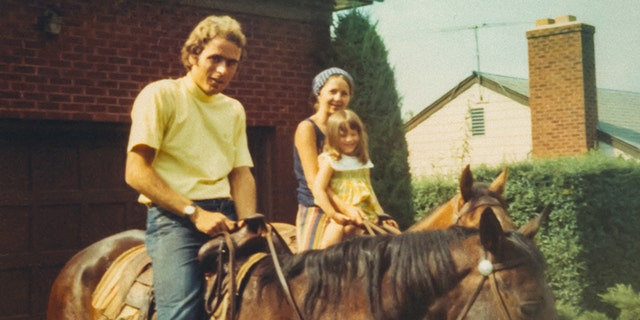 Elizabeth Kendall and her daughter Molly with Ted Bundy.