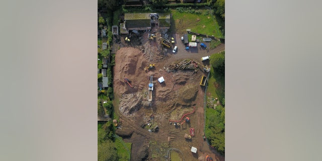 Aerial view of a police forensic tent erected on a building site off Scalford Road, Melton Mowbray. Police have launched an investigation after human bones were discovered on a building site in Melton Mowbray. (Credit: SWNS)