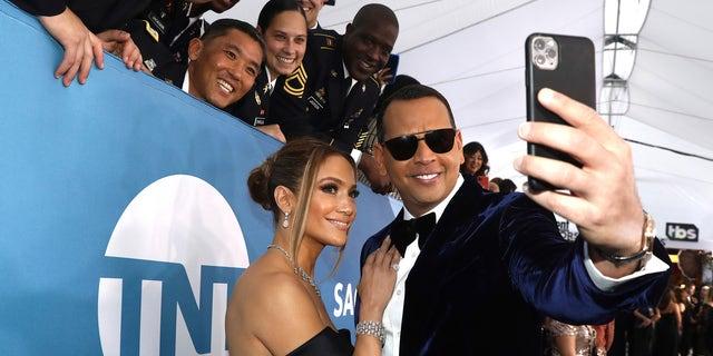 Alex Rodriguez Wears Jennifer Lopez's Dress in 'Flip the Switch' TikTok Challenge