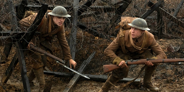 "This image released by Universal Pictures shows Dean-Charles Chapman, left, and George MacKay in a scene from ""1917."""