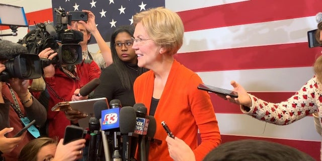 Democratic presidential candidate Sen. Elizabeth Warren speaks with reporters while campaigning in Marshalltown, Iowa on Jan. 12, 2019
