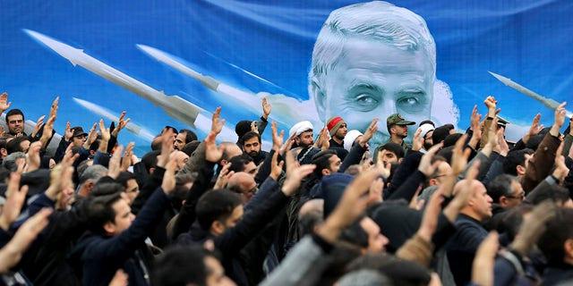 Protesters demonstrate over the U.S. airstrike in Iraq that killed Iranian Revolutionary Guard Gen. Qassem Soleimani in Tehran, Iran, Saturday Jan. 4, 2020. (Associated Press)