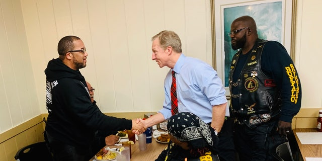 Tom Steyer chats with members of the Buffalo Soldiers bike gang at the Thunderbird Inn Buffet in Florence, S.C., Jan. 19.