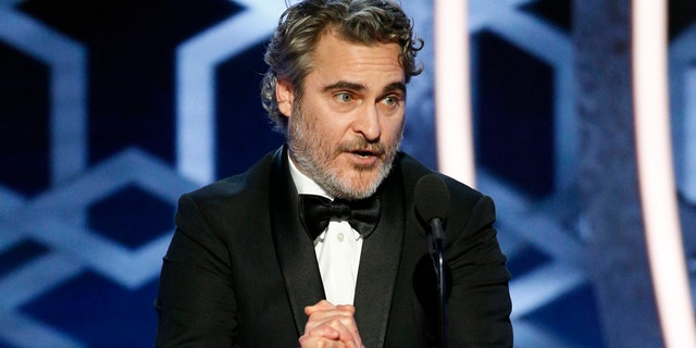 "This image released by NBC shows Joaquin Phoenix accepting the award for best actor in a motion picture drama for his role in ""Joker"" at the 77th Annual Golden Globe Awards at the Beverly Hilton Hotel in Beverly Hills, Calif., on Sunday, Jan. 5, 2020."