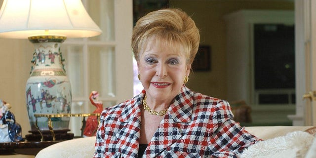 "Author Mary Higgins Clark poses in her home in Saddle River, N.J., June 3, 2004. Clark, the tireless and long-reigning ""Queen of Suspense"" whose tales of women beating the odds made her one of the world's most popular writers, died Friday, Jan. 31, 2020, at age 92. (Associated Press)"