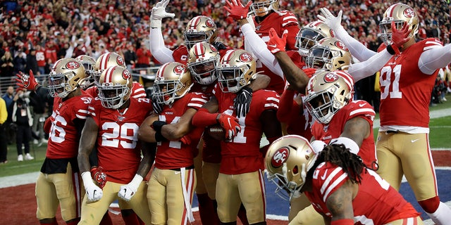 The San Francisco 49ers celebrating during the first half of the NFC Championship game Sunday. (AP Photo/Marcio Jose Sanchez)