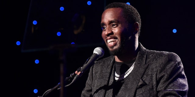 Sean 'Diddy' Combs accepts the President's Merit Award onstage during the Pre-GRAMMY Gala and GRAMMY Salute to Industry Icons Honoring Sean