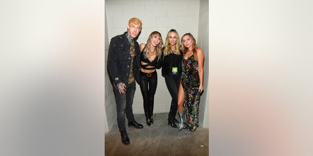 From left, Trace Cyrus, Miley Cyrus, Tish Cyrus and Brandi Cyrus pose backstage during the 2019 iHeartRadio Music Festival at T-Mobile Arena on September 21, 2019 in Las Vegas. (Photo by Kevin Mazur/Getty Images for iHeartMedia)