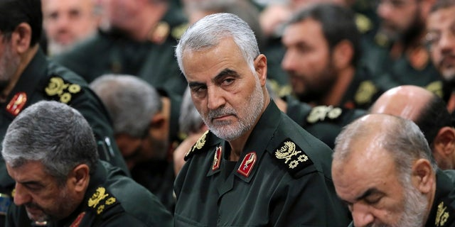 Revolutionary Guard Gen. Qassem Soleimani, center, is seen in this 2016 file photo. (Office of the Iranian Supreme Leader via AP, File)
