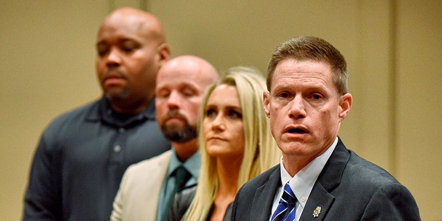 Dale County District Attorney Kirk Adams speaks about dropping murder charges against Carl Harris Jr. for the 1990 death of his wife during a news conference at Ozark City Hall, Ala., Monday, Jan. 13, 2020. Also shown are Jordan Davis, from right, Michael Bryant and Jimmy Culbreth. (Jay Hare/Dothan Eagle via AP)