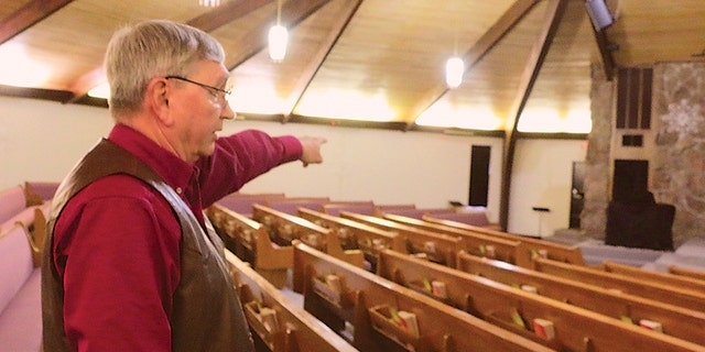 In this Dec. 27, 2019, photo, Bart Bartels, who leads the security team at Northfield Church in Gering, Neb., talks about how members of the church's security team. (Maunette Loeks/The Star-Herald via AP)