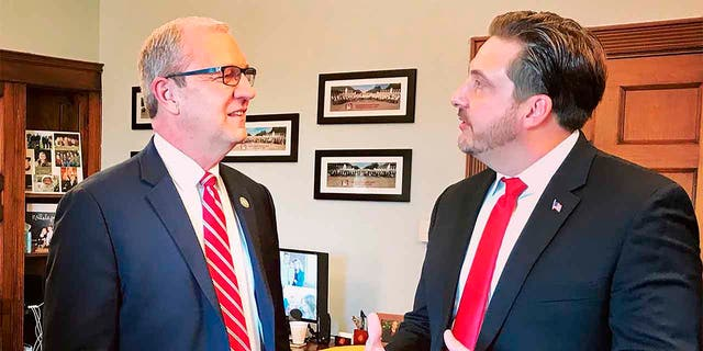 FILE - In this Jan. 30, 2019 photo, Tommy Fisher, right, talks with Sen. Kevin Cramer, R-N.D., at the lawmaker's office in Washington, D.C. (Sen. Kevin Cramer's office via AP, File)