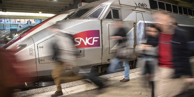 Travelers arrive at Gare Montparnasse train station during the 29th day of transport strikes in Paris, Thursday, Jan. 2, 2020. The start of 2020 was the second New Year celebration in a row where Macron has faced social upheaval.
