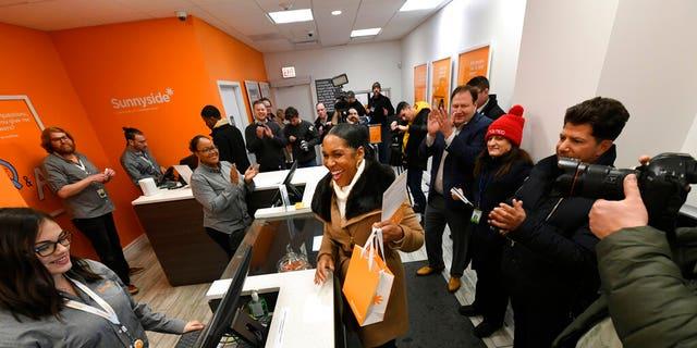 Illinois Lt. Gov. Juliana Stratton reacts after purchasing recreational marijuana at Sunnyside dispensary Wednesday, Jan. 1, 2020, in Chicago. (AP Photo/Paul Beaty)