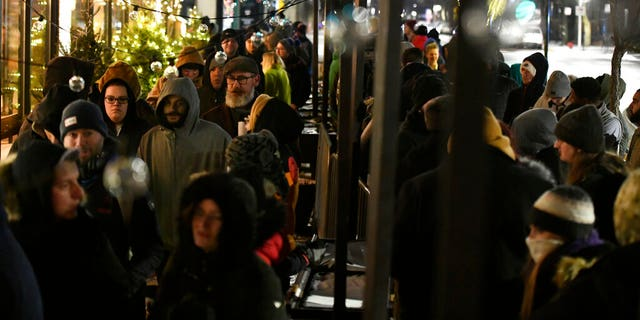 People began lining up on Wednesday at 6 a.m., the earliest that Illinois' new law allowed such sales. (AP Photo/Paul Beaty)