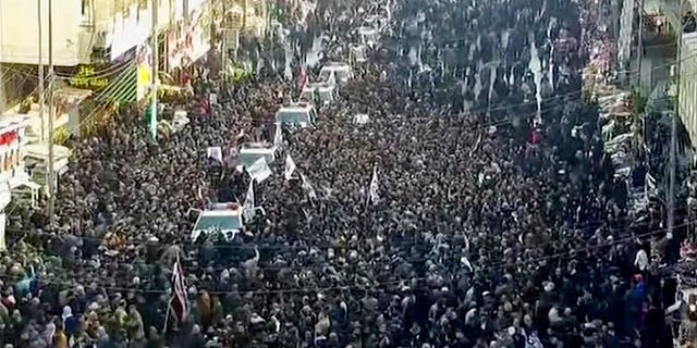 In this image made from a video, mourners gather for a funeral procession for Gen. Qassem Soleimani, in Baghdad Saturday, Jan. 4, 2020. (PMF Media Office via AP)