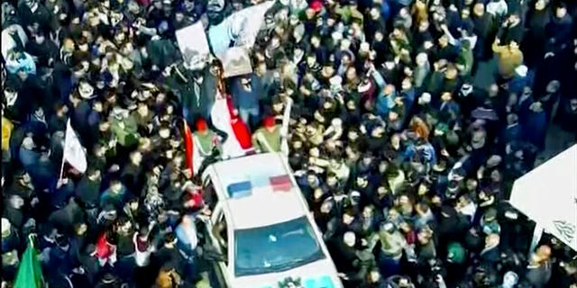 In this image made from a video, mourners gather for a funeral procession for Gen. Qassem Soleimani, in Baghdad Saturday, Jan. 4, 2020. The head of Iran's elite Quds force and mastermind of its regional security strategy, was killed in an airstrike early Friday near the Iraqi capital's international airport that has caused regional tensions to soar.