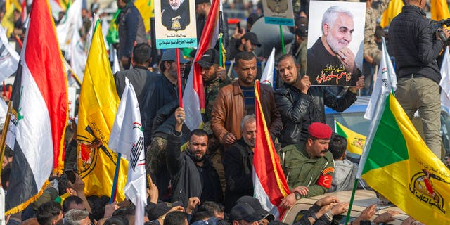 People attend the funeral of Iran's top general Qassem Soleimani and 9 Iranians and Iraqis, in Baghdad, Iraq, Saturday, Jan. 4, 2020.