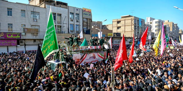 Flag-draped coffins of Gen. Qassem Soleimani and his comrades who were killed in Iraq in a U.S. drone strike are carried on a truck surrounded by mourners during their funeral in southwestern city of Ahvaz, Iran, Sunday, Jan. 5, 2020. (Alireza Mohammadi/ISNA via AP)