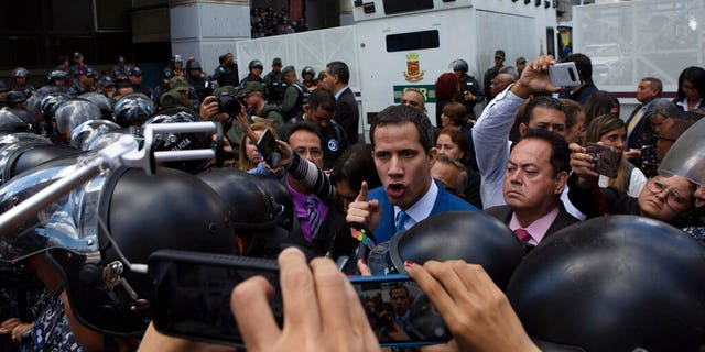 National Assembly President Juan Guaidó, Venezuela's opposition leader, arguing with police as he and other lawmakers were stopped a few blocks from the Assembly where he had been set to lead the session to elect new leadership in Caracas.