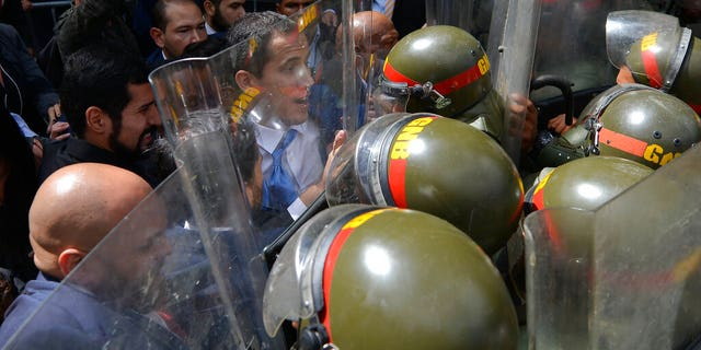 National Assembly President Juan Guaidó, Venezuela's opposition leader, was blocked by national guardsmen from entering the compound of the Assembly, where he was to lead a session to elect new leadership in Caracas.