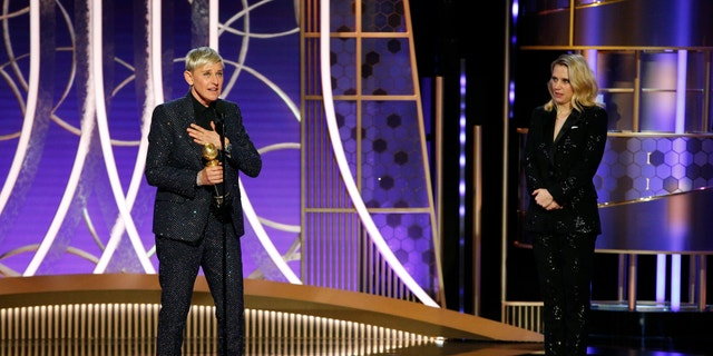 This image released by NBC shows Ellen DeGeneres accepts the Carol Burnett TV Achievement Award as presenter Kate McKinnon, right, looks on at the 77th Annual Golden Globe Awards.