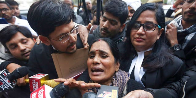 Asha Devi, mother of the victim of the fatal 2012 gang rape on a moving bus, speaks to the media as she leaves a court in New Delhi, India, Tuesday, Jan. 7, 2020. A