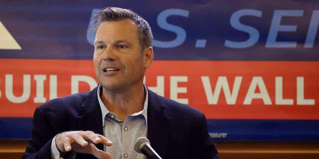 FILE- In this July 8, 2019 file photo, former Kansas Secretary of State Kris Kobach addresses the crowd as he announces his candidacy for the Republican nomination for the U.S. Senate in Leavenworth, Kan. (AP Photo/Charlie Riedel, File)