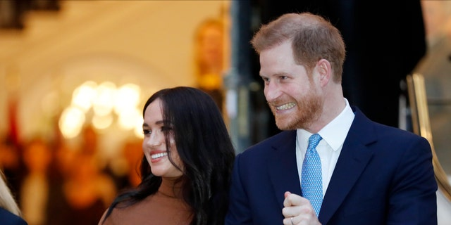 FILE - In this Tuesday Jan. 7, 2020 file photo Britain's Prince Harry and Meghan, Duchess of Sussex leave after visiting Canada House in London after their recent stay in Canada. (AP Photo/Frank Augstein, FILE)