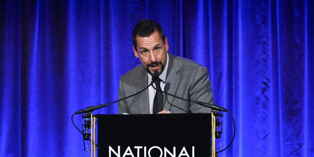 "Actor Adam Sandler accepts the best actor award for ""Uncut Gems"" at the National Board of Review Awards gala at Cipriani 42nd Street on Wednesday, Jan. 8, 2020, in New York."