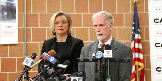 Dr. Tom Wake, the interim administrator of Cook County Animal and Rabies Control, speaks with reporters in Chicago, Thursday, Jan. 9, 2020, while Kelley Gandurski, executive director of the Chicago Animal Care and Control, stands next to him.