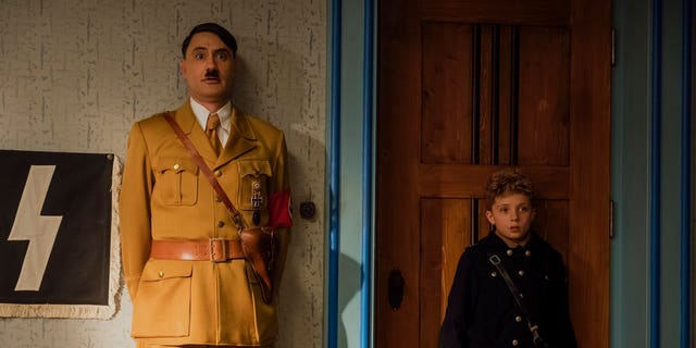 "This image released by Fox Searchlight Pictures shows Taika Waititi, left, and Roman Griffin Davis in a scene from ""Jojo Rabbit."""