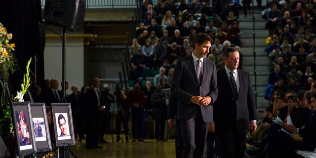 Canadian Prime Minister Justin Trudeau, left, with Alberta Premier Jason Kenney on Sunday during a memorial in Edmonton for the victims of the Ukrainian plane disaster in Iran this past week.