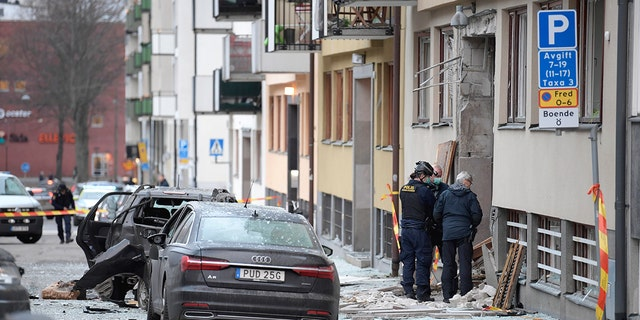 Police work at the scene of an explosion which caused damage to a residential building in central Stockholm, Monday, Jan. 13, 2020. There were no reported injuries. (Janerik Henriksson /TT News Agency via AP)