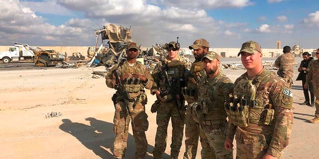 U.S. Soldiers stand at a site of Iranian bombing at Ain al-Asad airbase in Anbar, Iraq, Monday, Jan. 13, 2020.