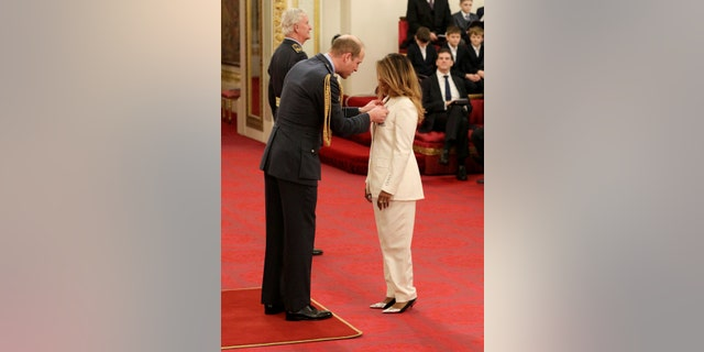 Rapper and singer MIA, real name Mathangi Arulpragasam, is made an MBE by Prince William Duke of Cambridge, left, at Buckingham Palace, in London, Tuesday Jan. 14, 2020. The honorary award is conferred in recognition of contributions to the arts, sport, sciences, and charitable works.