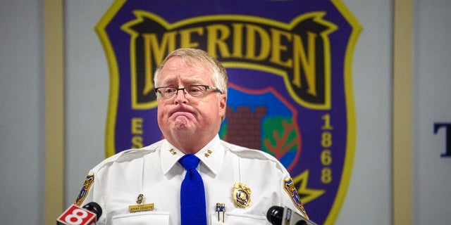 Meriden, Conn., Police chief Jeffry Cossette announces that the identity of the mother of an abandoned infant found dead in 1988 has been established, during a Tuesday news conference. (Mark Mirko/Hartford Courant via AP)