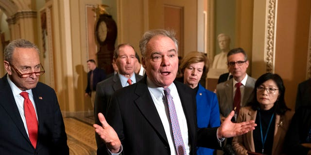 Sen. Tim Kaine, D-Va., center, joined from left by Senate Minority Leader Chuck Schumer, D-N.Y., Sen. Tom Udall, D-N.M., and Sen. Tammy Baldwin, D-Wis., meets with reporters as the House prepares to send the articles of impeachment against President Trump to the Senate, at the Capitol in Washington, Tuesday, Jan. 14, 2020. Kaine also discussed his War Powers Resolution that the Senate is expected to vote on soon. (AP Photo/J. Scott Applewhite)