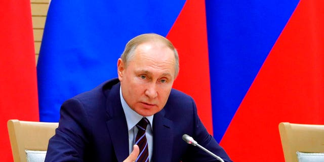 Russian President Vladimir Putin speaks as he chairs a meeting on drafting constitutional changes at the Novo-Ogaryovo residence outside Moscow, Russia.