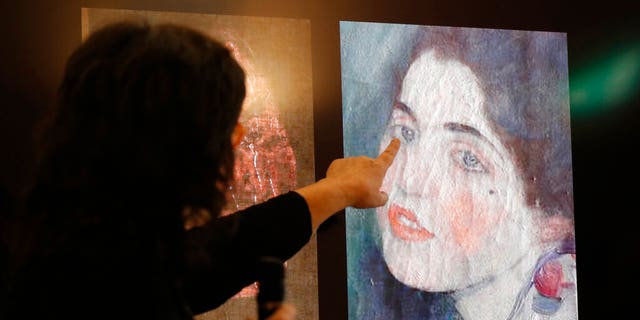 Art experts have confirmed that a stolen painting discovered hidden inside an Italian art gallery's walls is indeed the same stolen in 1997.