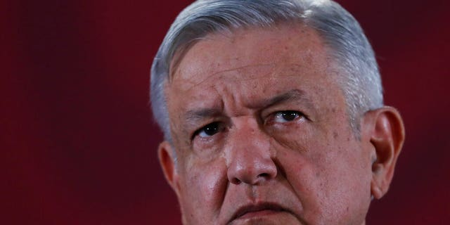 FILE: Mexican President Andres Manuel Lopez Obrador listens to questions during his daily morning press conference at the National Palace in Mexico City.